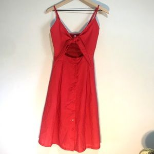 Dresses & Skirts - Red Dress with Cut our detail